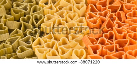 italian flag made from color pasta in shape of heart - stock photo