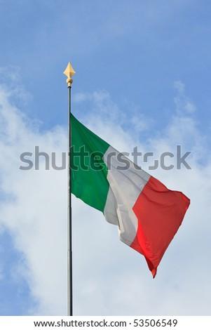 Italian flag on a sunny day with  blue sky background - stock photo