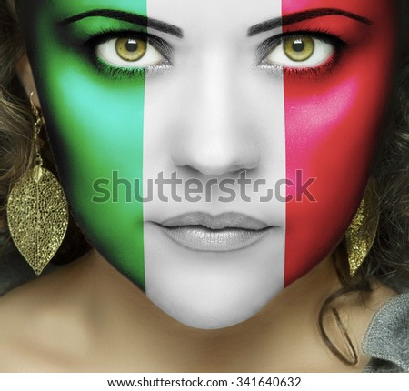Italian flag on face of woman with green eyes  - stock photo