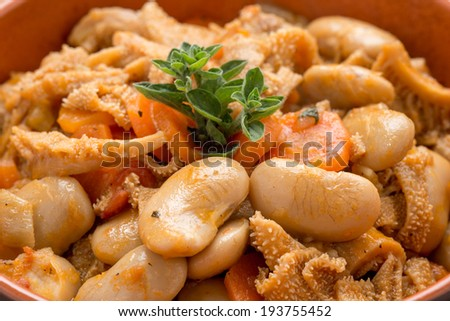 Italian foiolo with beans in terracotta bowl