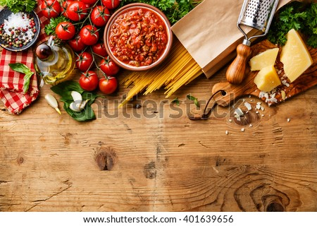 Italian food background with Spaghetti Bolognese ingredients - stock photo