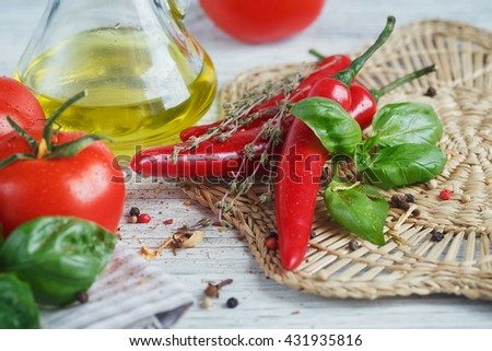 Italian food background, with tomatoes, basil, olive oil, peppercorns, chili pepper and thyme. Food concept. - stock photo