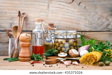 Italian food concept pasta with vegetables olive oil flavored and sesame oil with spices herb rosemary ,thyme,dill,sage,parsley and champignon mushroom set up with old wooden background.
