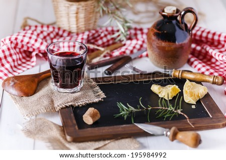 Italian food concept: red wine in a table-glass over white wooden background. Selective focus, Shallow DoF