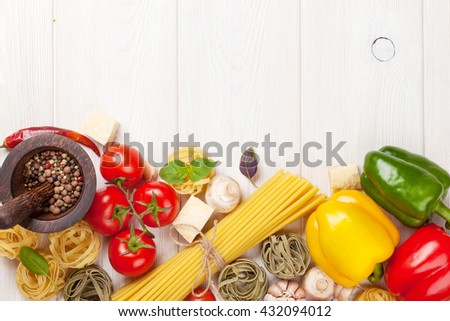 Italian food cooking ingredients. Pasta, tomatoes, peppers. Top view with copy space - stock photo