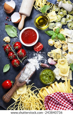 Italian food - Fresh Pasta with sauces and ingredients - stock photo
