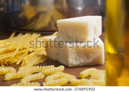 italian food mediterranean cooking pasta still life different kinds of pasta cheese and olive oil - stock photo