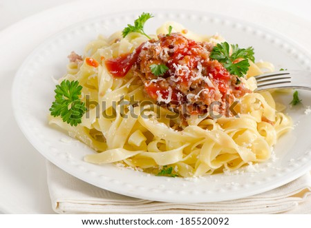 Italian food - Pasta bolognese with fresh herbs