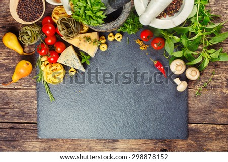 Italian food, pasta, cheese, vegetables and spices. Food background with copyspace - stock photo