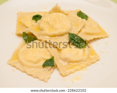 Italian food - ravioli with butter and sage - stock photo