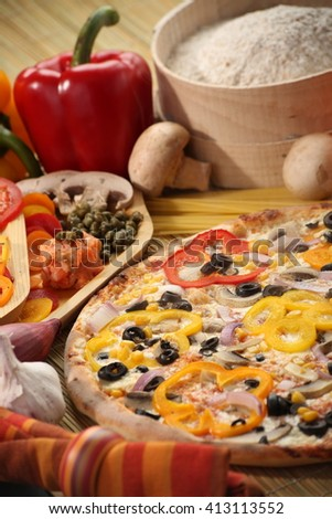 Italian food setup with pizza and vegetable