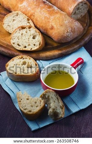 Italian fresh bread   and olive oil, selective focus