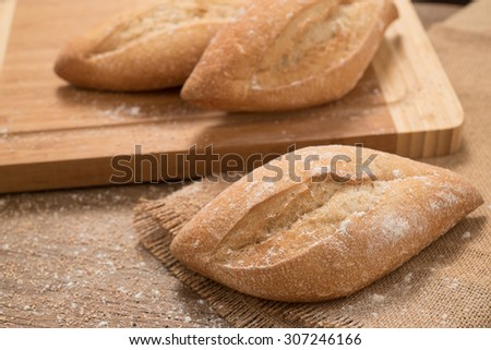 Italian fresh homemade bread  on a wooden cutting board