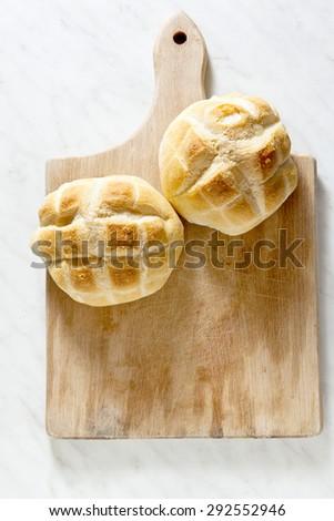 Italian fresh homemade bread turtle on a wooden cutting board - stock photo