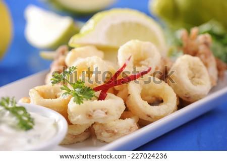 Italian fried calamari rings   - stock photo