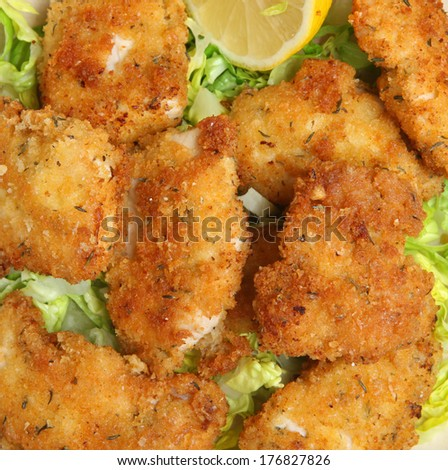 Italian fried chicken goujons with breadcrumbs, Parmesan cheese and oregano.