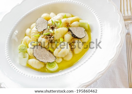 Italian gnocchi with onion and truffle - stock photo