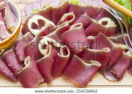 Italian ham prosciutto and salami  - stock photo