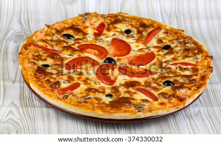 Italian homemade pizza with tomato, cheese and olives