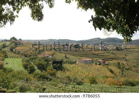 Italian landscape with green hills and trees - stock photo