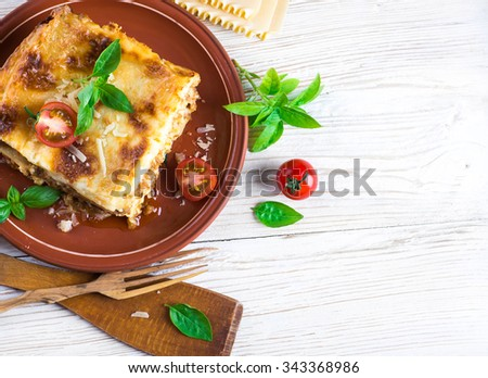 Italian lasagna, pasta dish with minced meat and parmesan cheese - stock photo
