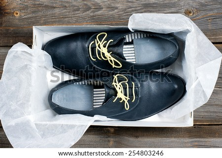 italian leather shoes concept: boots laced with spaghetti
