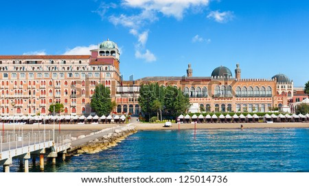 Italian luxury seaside resort hotel from the art deco era.  Location: Lido, Italy, near Venice. Wide angle shot viewed from the water. - stock photo