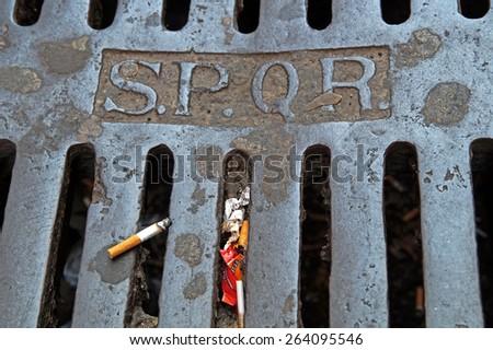 Italian manhole in rome - stock photo