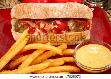 Italian meatball sandwich, spicy fries and honey mustard sauce. - stock photo