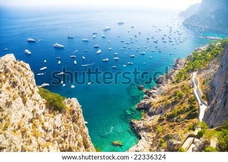 Italian Mediterranean sea coast. View on sea and ships. - stock photo