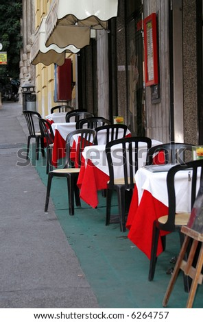 Italian outdoor cafe on a side street of Rome. - stock photo