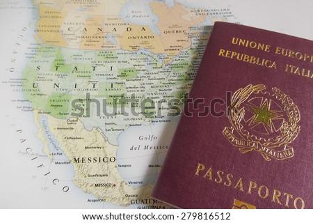 Italian passport over USA map - stock photo