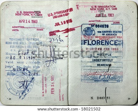 Italian passport. USA entry visa and border stamps.Greece entry visa. - stock photo