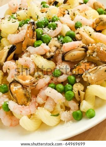 Italian pasta cavatappi with mussels, shrimps and green peas. Shallow dof. - stock photo