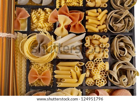 Italian pasta collection in wooden box surface top view background - stock photo