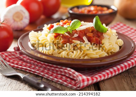 italian pasta fusilli with tomato sauce and basil - stock photo
