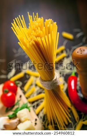 Italian pasta on table, raw food - stock photo