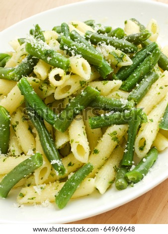 Italian pasta penne with pesto sauce and green beans. Shallow dof. - stock photo