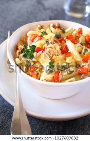 Italian pasta penne with with tuna, bell pepper and cappers salad