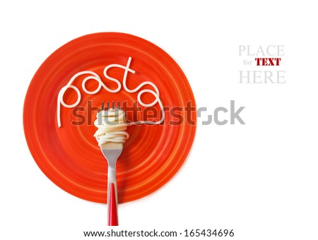 Italian pasta spaghetti with fork on a red plate. - stock photo