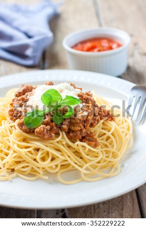italian pasta spaghetti with meat and tomato sauce on white plate