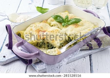 Italian pasta stuffed with spinach - Cannelloni Ricotta e Spinaci - stock photo