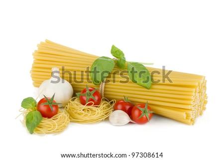 Italian pasta, tomatoes, basil and garlic. Isolated on white background - stock photo