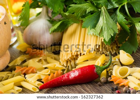 Italian pasta, vegetables and spices, still life