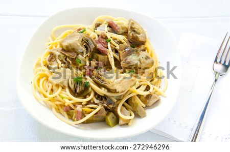 Italian Pasta with artichokes and Parmesan - stock photo