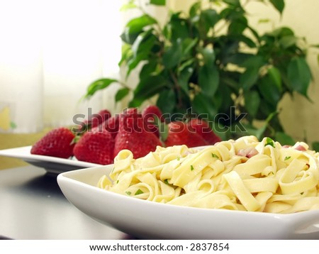 italian pasta with bacon and parsley on decorated table