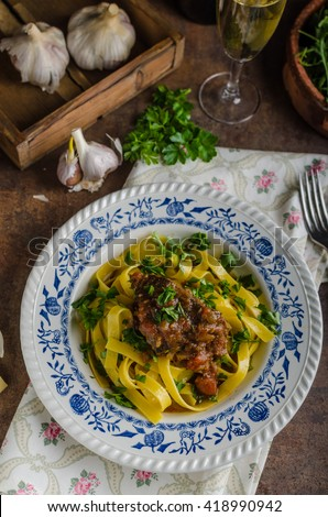 Italian pasta with beef stew, rustic food, lots of delicious flavours - stock photo