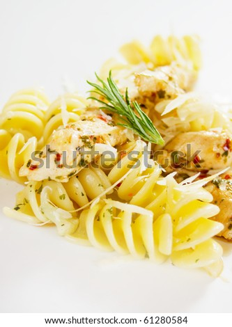 Italian pasta with chicken meat and grated parmesan cheese - stock photo