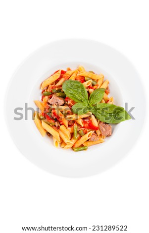 Italian pasta with stewed vegetables in bowl, isolated on white background. Top view. - stock photo