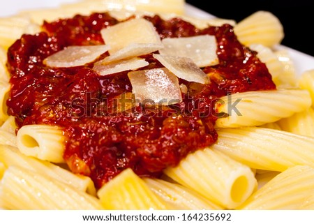 Italian Pasta with tomato sauce and parmesan cheese - stock photo